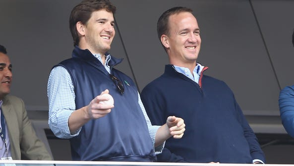 Brothers Eli Manning of the New York Giants and retired