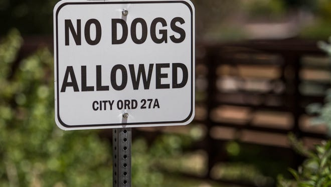 "A ""no dogs allowed"" sign is posted at a park in Cedar City."