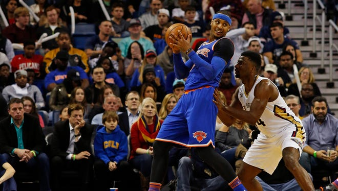 Knicks forward Carmelo Anthony (7) leans into New Orleans Pelicans forward Solomon Hill (44) in the second half of an NBA basketball game in New Orleans, Friday, Dec. 30, 2016. The Pelicans won 104-92.