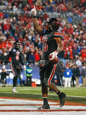 Louisville's Brandon Radcliff celebrates his lone touchdown in the second half at the 2014 Belk Bowl in Charlotte, North Carolina Tuesday evening. Radcliff had 89 yards as Georgia beat Louisville 38-14.  Dec. 30, 2014 By Matt Stone/The Courier-Journal