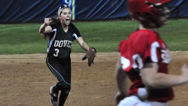 Dover High School third baseman Caroline Schoenbucher celebrates her throw to first base for the final out to secure the Green Wave's first state softball title in 2014, an 8-4 victory over rival Spaulding.