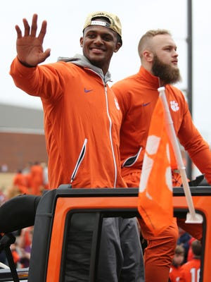 Clemson Tigers quarterback Deshaun Watson greets fans during the College Football Playoff National Championship celebration parade in downtown Clemson prior to a ceremony at Memorial Stadium.