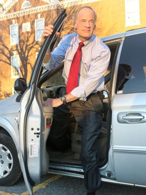 U.S. Sen. Tom Carper gets out of his beloved 2001 Chrysler Town & Country minivan Friday in front Legislative Hall in Dover.