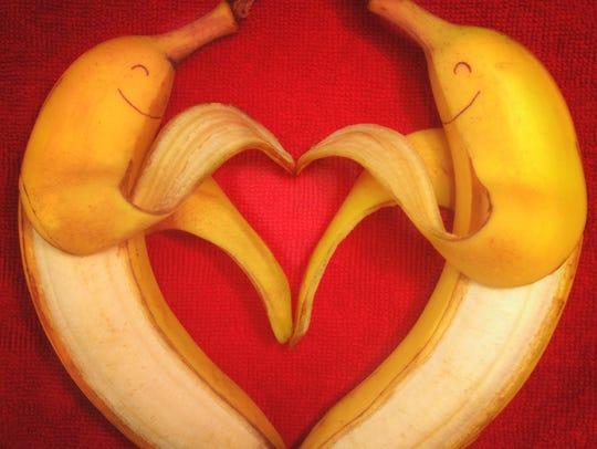 Two bananas making a heart.