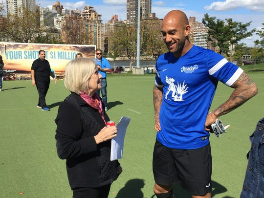 "Executive Director  of the NJ Center for Tourette Syndrome Faith Rice chats with longtime NJCTS supporter Tim Howard at the El Jimador Tequila ""Your Shot at $1 Million"" shootout Wednesday. Howard raised $105,000 for the Somerville-based nonprofit at the event."