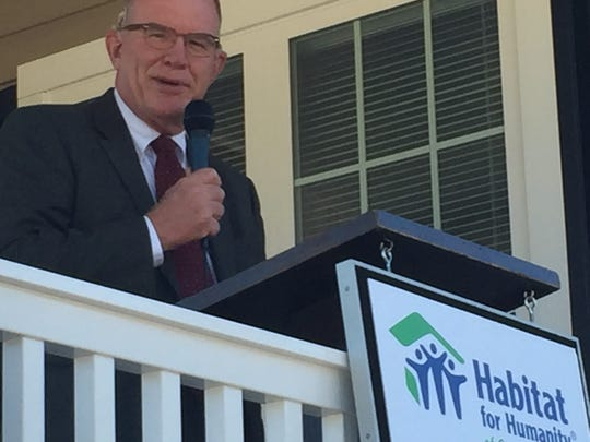 Monroe Free, CEO and president of Habitat for Humanity of Greenville County, speaks during the organization's dedication ceremony for its 330th home build.