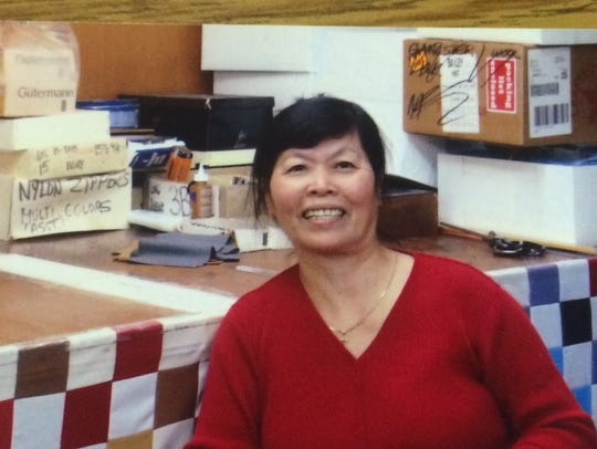 Kim Dao sits in a former workplace in this undated