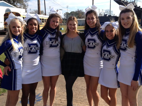 "Bolton High senior and cheer captain Molly Parks (third from left) stands with fellow cheerleaders and actress Olivia Holt (center), who is one of the leads in ""Class Rank."" The movie is being filmed in Alexandria, including scenes shot at Bolton on Wednesday."