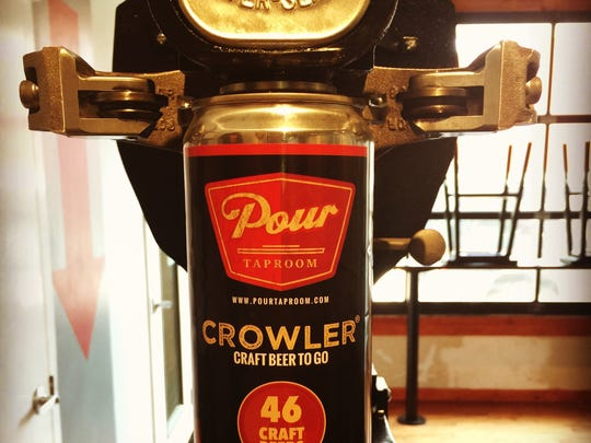 The Pour Taproom features a canning system that allows customers to take craft beer to go in a large, sealable can, similar to a growler.