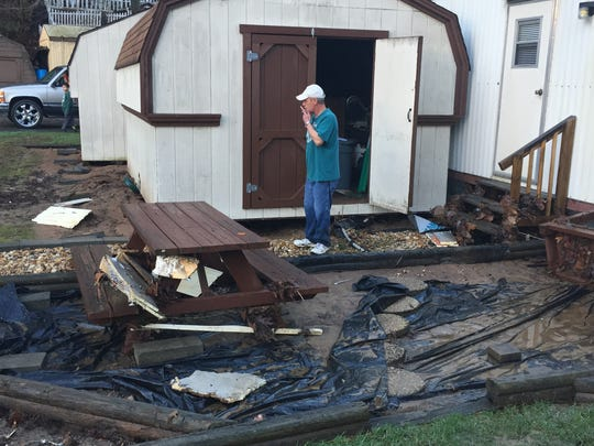 John Thorpe surveys the damage to his property in Fernwood mobile home park off U.S. 74 in East Asheville.