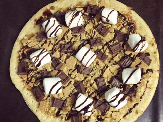 A s'mores-inspired pizza makes a dessert out of the campfire treat.