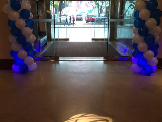 The Renaissance Savery Hotel lobby welcomed NCAA basketball fans with balloons and a projected basketball logo on the floor.