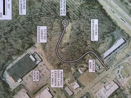 The preliminary development plan, presented by Jacobi, Toombs & Lanz at Tuesday's New Albany redevelopment commission meeting. The road that starts at State Street and ends with a roundabout was approved by the commission today.