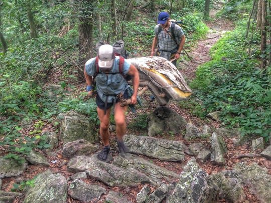 "Seth ""Cap"" Orme (front) and Joe ""Goose"" Dehnert packing out 70 pounds of wet mattresses from the Appalachian Trail last year."