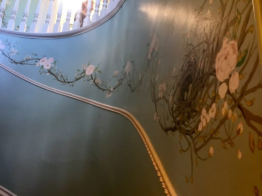 This mural by artist Temre Stanchfield winds up the main staircase.