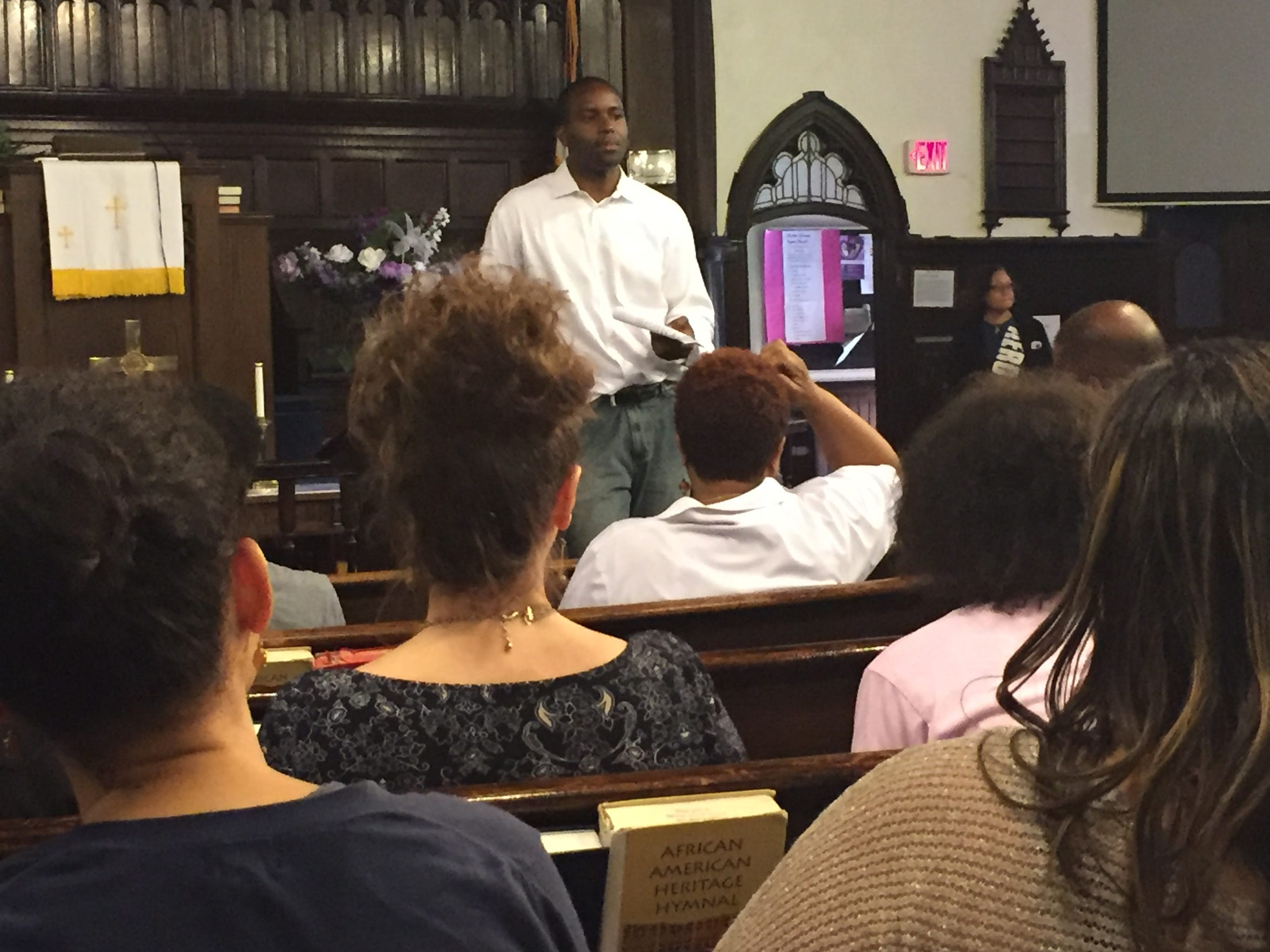 Eugene Young leads a forum at the Mother Africa Union Church on how to keep young teens off the streets and out of trouble with the law.