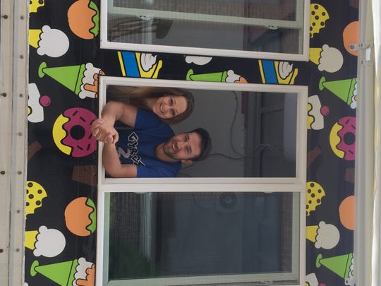 Greg Lee, owner of the Gyros2Go food truck and Greece e Spoon restaurant, poses with his wife, Nikki, inside the couple's newest endeavor, a dessert-themed food truck named Sweet e Sweets.