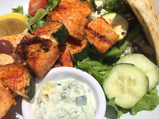 A salmon kebab at Zoes Kitchen is served with a side salad and cucumber sauce dressing. The fast-casual Mediterranean eatery will debut Tuesday in Fort Collins.