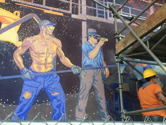 Joe Schwope (left on mural) and Emil Weston are shown as workers at Cincinnati Milling Machine Co., now Milacron. The mural is one of nine being prepared for display outside the Duke Energy Convention Center in Cincinnati.