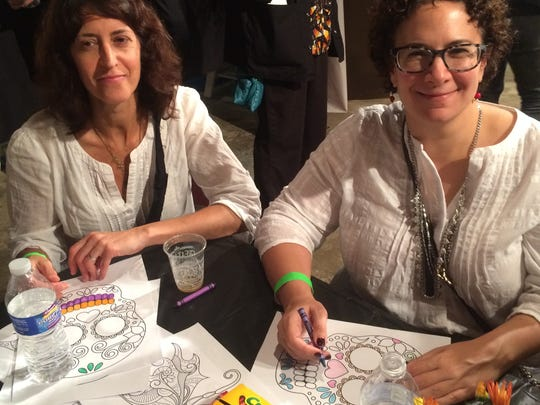 Sharon Hackett of Haddon Township and Michelle Macaluso of Collingswood color during last year's #BeforeIDie event.