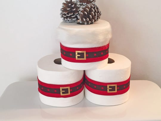 Add some simple festivity to your bathroom by wrapping toilet paper in ribbon.