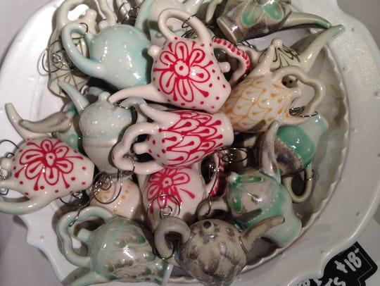 Ceramic artist Amelia Stamps creates small teapot ornaments