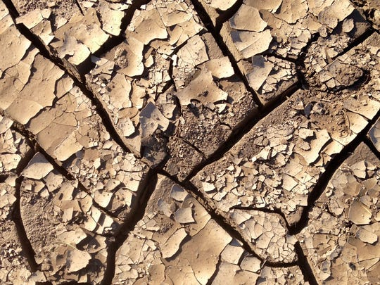Dry, cracked ground -- a result of California's drought.