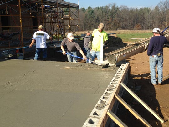 Concrete is poured during the construction of a house