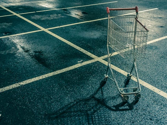 Small shopping cart in the parking lot.