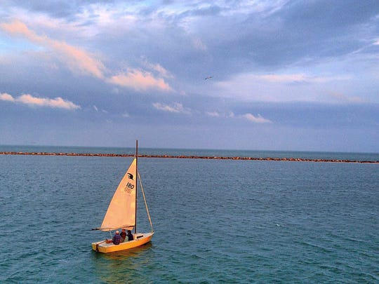 A sailboat is underway near the Corpus Christi Marina.