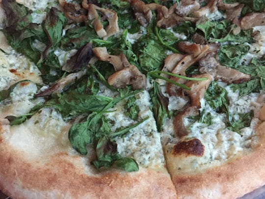 The wood-fired pizza with  whipped goat cheese, spinach and oyster mushrooms at Wolf Peach, 1818 N. Hubbard St.