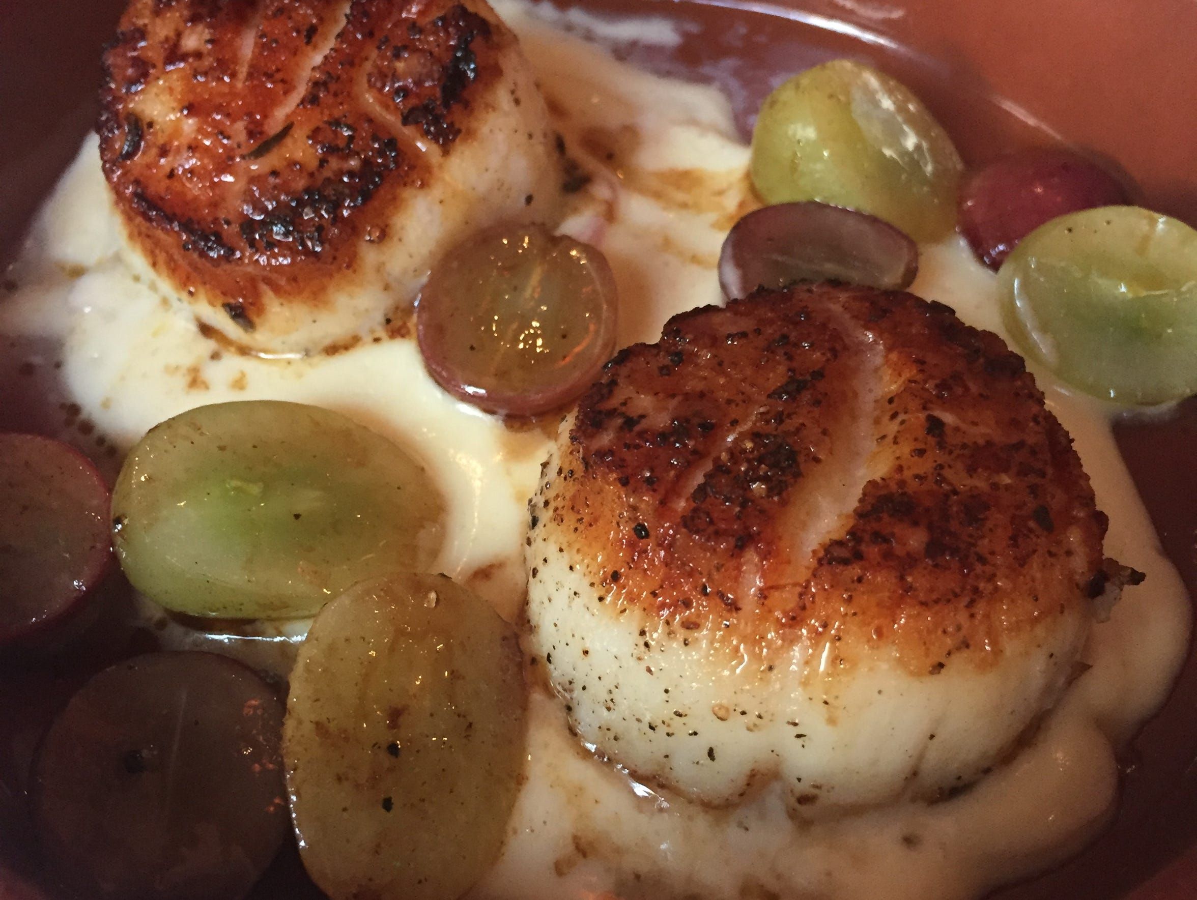 Scallops sauteed with grapes were a Tuesday tapas special