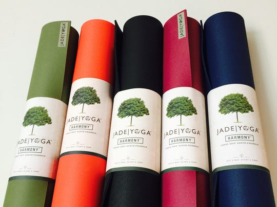 Quality yoga mats make a great gift, whether for a committed yogi or someone trying yoga for the first time. These mats are by Jade Yoga and are sold at Peace Love Yoga studios and massage in Vineland.