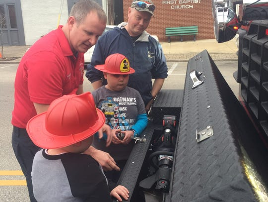 HFD firefighter Eddie Payne shows a battery-powered