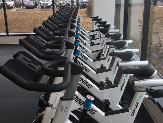 Stationary bikes line a wall in  Subaru of America's
