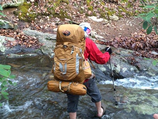 Kent Dykes crosses a stream on the Appalachian Trail.
