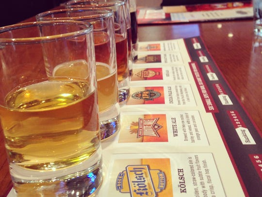Stop 7: Samples of beer at Rock Bottom Brewery are served on a menu that gives a description of each beer.
