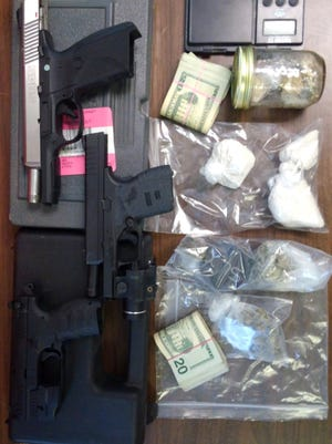 Over 100 grams of heroin, drug paraphernalia, guns, and cash were discovered in a drug bust on Arch Street Wednesday afternoon.
