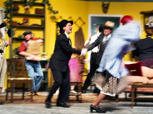 """A chaotic scene where the FBI arrests everyone in DreamWrights production of """"You Can't Take It With You"""" during a dress rehearsal Monday March 18, 2013.  YORK DAILY RECORD/SUNDAY NEWS - PAUL KUEHNEL"""