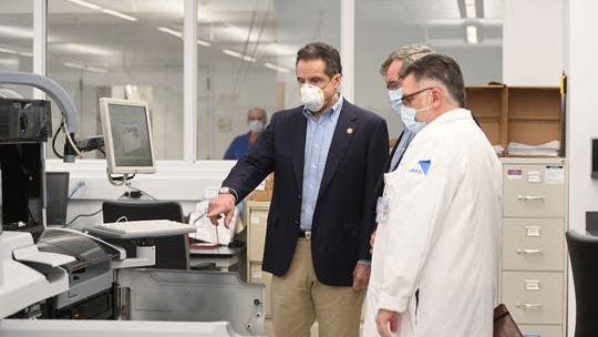 Gov. Andrew M. Cuomo, joined by Northwell Health President and C.E.O. Michael Dowling, tours the Northwell Health Core Lab in New Hyde Park before delivering his daily COVID-19 Coronavirus briefing on Sunday April 19, 2020.
