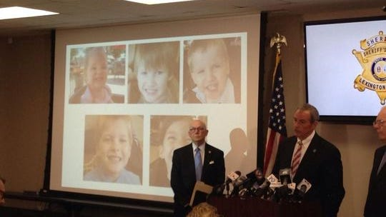 SLED Chief Mark Keel stands at the podium beside a projection of the images of the children who were killed.