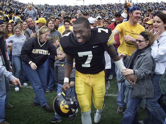 Brad Banks celebrates with fans during Iowa's magical