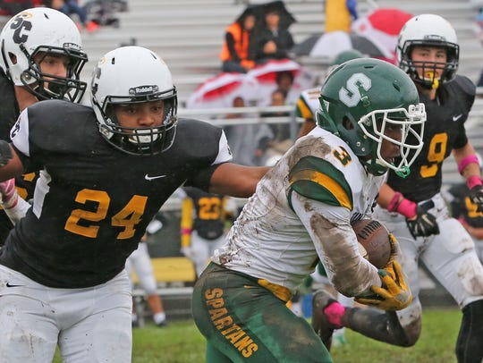 Martin Luther running back Darios Garrett runs past
