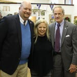 John Fleming (left), director of Small Business Administration Delaware, 2nd Act Antiques owner Michelle Quaranta and U.S. Sen. Tom Carper pose during an event to mark the extension of the Tubman Byway Initiative to Historic New Castle.