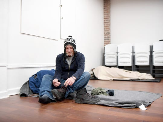 """Really it's a blessing if you find yourself in a position where you don't have shelter,"" Michael Halsey said of Western Carolina Rescue Ministries taking in extra people for Code Purple when the temperature drops below freezing as he prepared his mat for bed in the downtown shelter's chapel on Thursday, Dec. 28, 2017. If not for the code Halsey said he would be outside in a tent for the night. ""It's dangerous, you could freeze to death, I don't want to go there."""