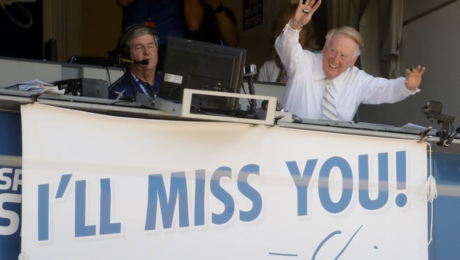 Vin Scully, a Hall of Fame broadcaster who is in the final days of his 67-year career covering Los Angeles Dodgers baseball games, waves to the fans at Dodger Stadium before a baseball game against the Colorado Rockies in Los Angeles, Sunday, Sept. 25, 2016.