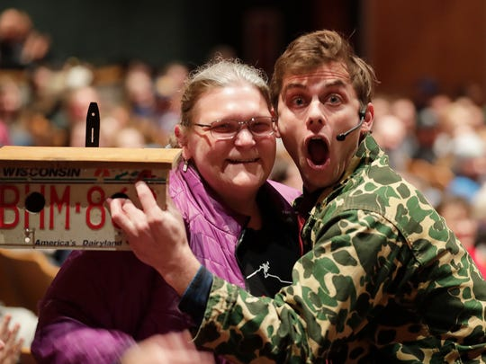 Charlie Berens brought his Manitowoc Minute to the Weidner Center for the Performing Arts at UW-Green Bay Tuesday, March 6, 2018 in Green Bay, Wis. He mugs it up with an audience member that donated $300 to the Wounded Warriors Project by buying a bird house made from Wisconsin license plates.