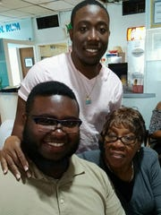 Larimar Webbe, center, with family.