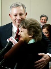 Carolyn Levine, the mother of Janet March, hugs Deputy District Attorney General Tom Thurman after the jury's guilty verdict against Perry March at the Justice A.A. Birch Building on Aug. 17, 2006.