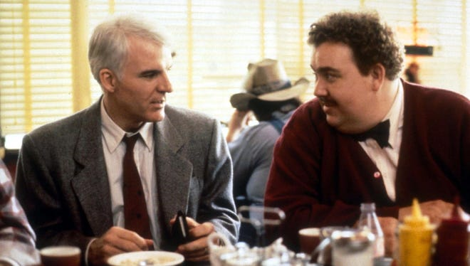 "Hapless businessman Steve Martin can't rid himself of obnoxious fellow traveler John Candy on a series of ""Planes, Trains & Automobiles."""